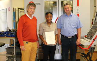Congratulations! The Trainee Award 2018 goes to Mrs. Laetitia Djayou: Handing over of the certificate and a cash prize by the managing director Prof. Heinrich Bülthoff, the award winner Mrs. Laetitia Djayou and the workshop manager Markus Scheu (f.l.t.r.). Copyright: Beate Fülle/Max Planck Institute for Biological Cybernetics