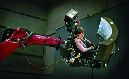 Prof. Dr. Heinrich Bülthoff conducting a perception experiment in the flight simulator in of the Cyberneum in Tübingen. Image: Anne Faden/Max Planck Institute for Biological Cybernetics